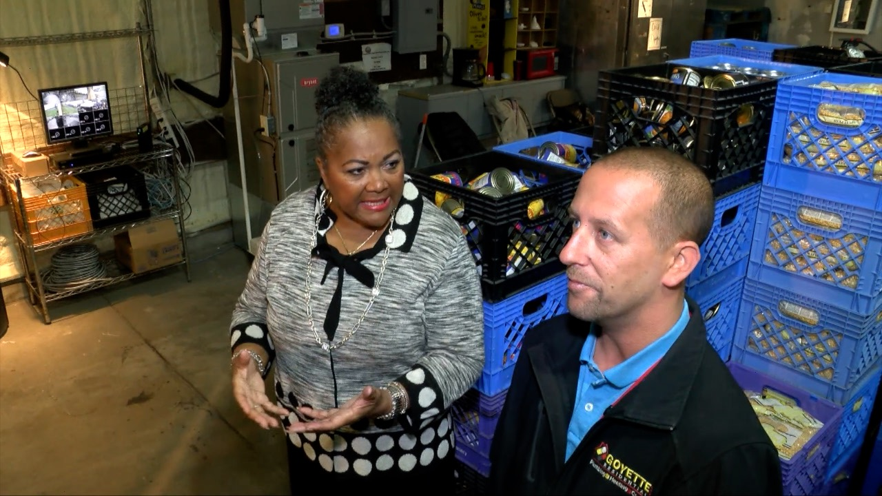 Sandra Jones, executive director of the R.L. Jones Community Outreach Center speaks with Mike Anson of Goyette Mechanical.