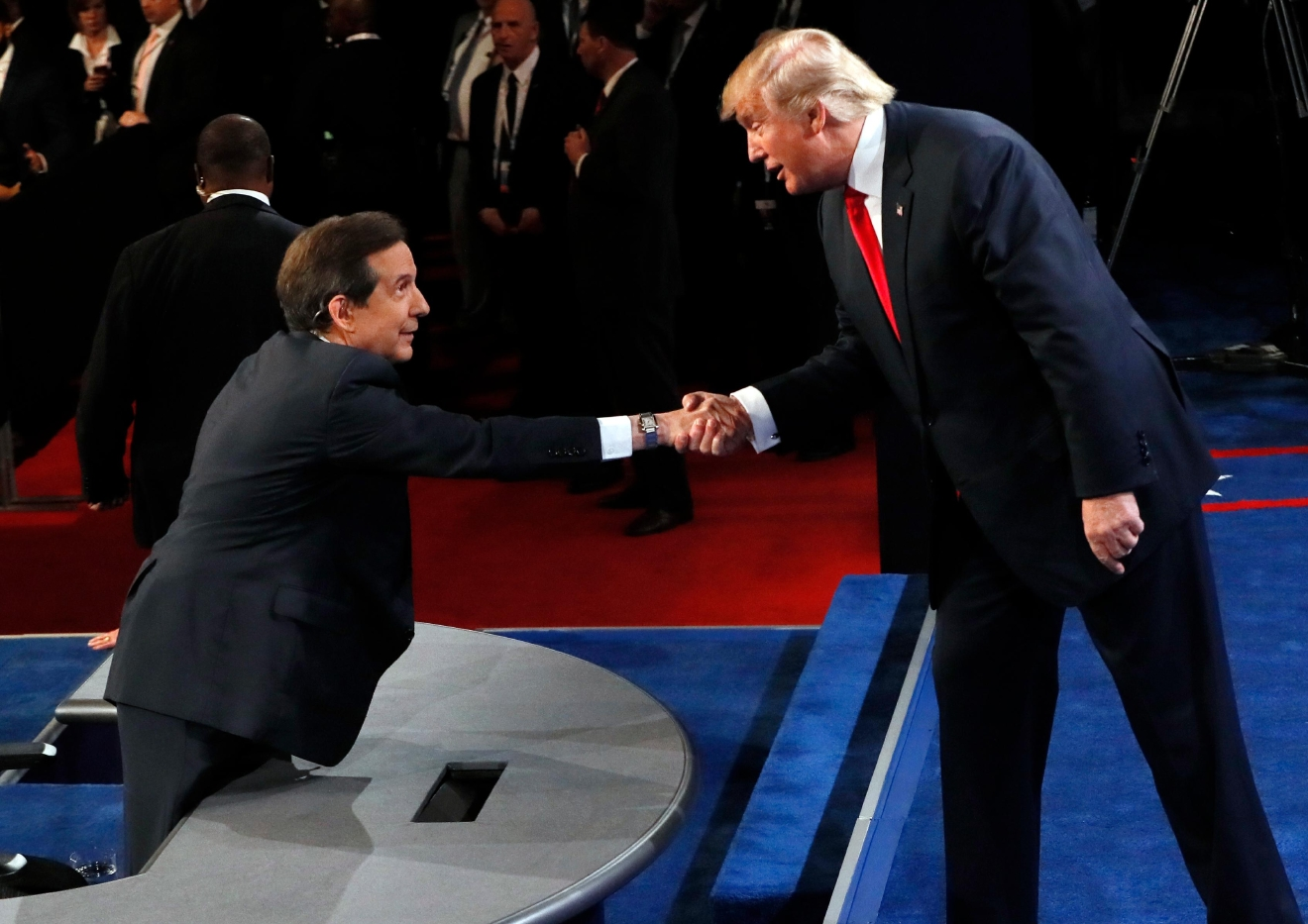 Republican presidential nominee Donald Trump shakes hands with moderator Chris Wallace, of FOX News, after the third presidential debate at UNLV in Las Vegas, Wednesday, Oct. 19, 2016. (Mark Ralston/Pool via AP)