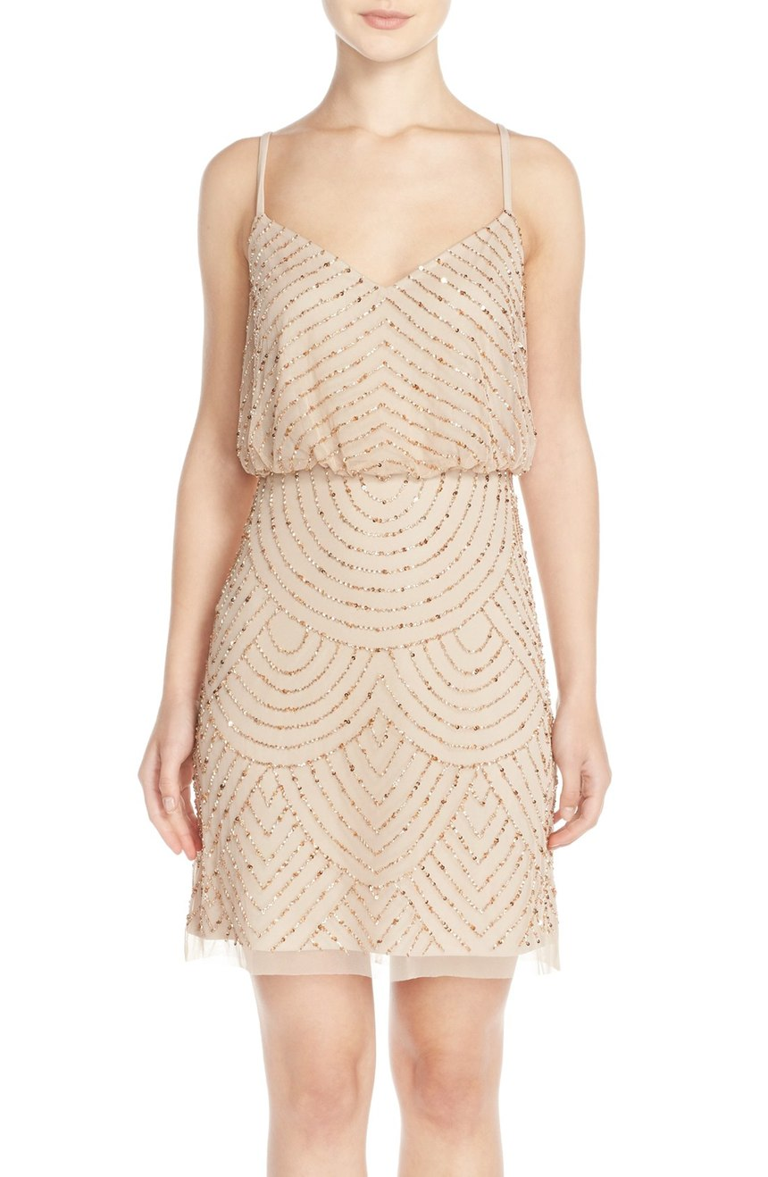 This nude 'Sequin Mesh Blouson Dress' is super classy.  Add a rocker chic twist with a leather coat and laced up heels. $198.00  (Image: Nordstrom)