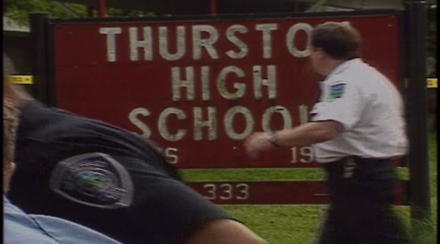 A 15-year-old shot and killed students Ben Walker and Mikael Nickolauson and wounded 26 others May 21, 1998, at Thurston High School, after killing his parents the day before. (Still from file video)
