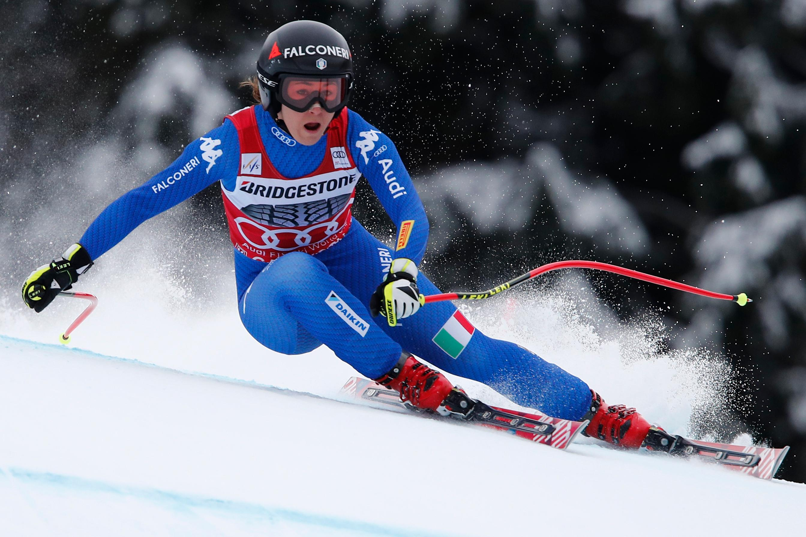 File- This Feb. 3, 2018, file photo shows Italy's Sofia Goggia competing during an alpine ski, women's world Cup downhill race, in Garmisch Partenkirchen, Germany.  The Olympic speed courses at Jeongseon were raced just once on each World Cup circuit. In the women's test race last year, Goggia beat Lindsey Vonn of the U.S. on a slightly different course setting.  (AP Photo/Gabriele Facciotti, File)