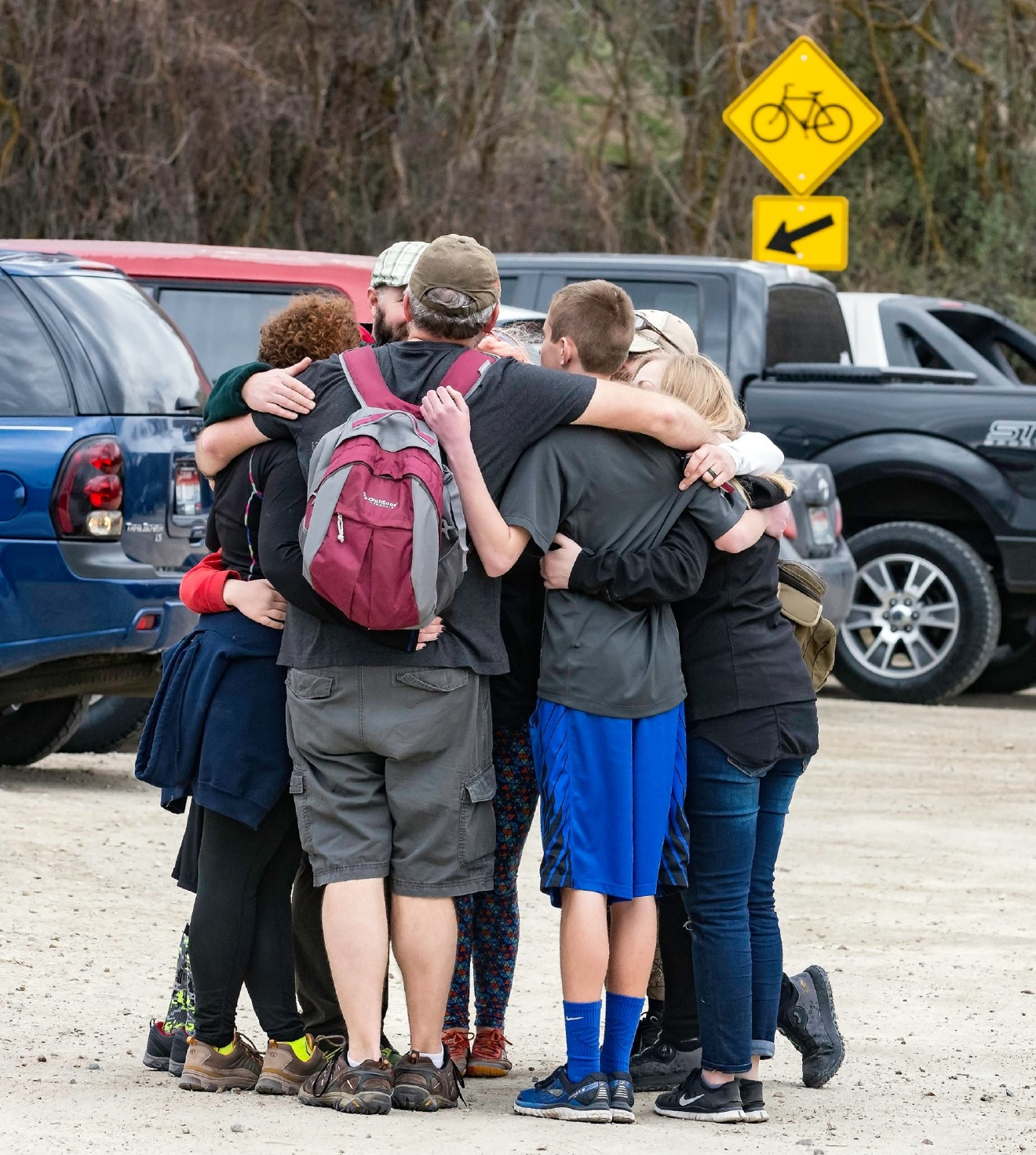 A group of hikers hug as the scene calms down. (Photo Courtesy Mark Goforth)