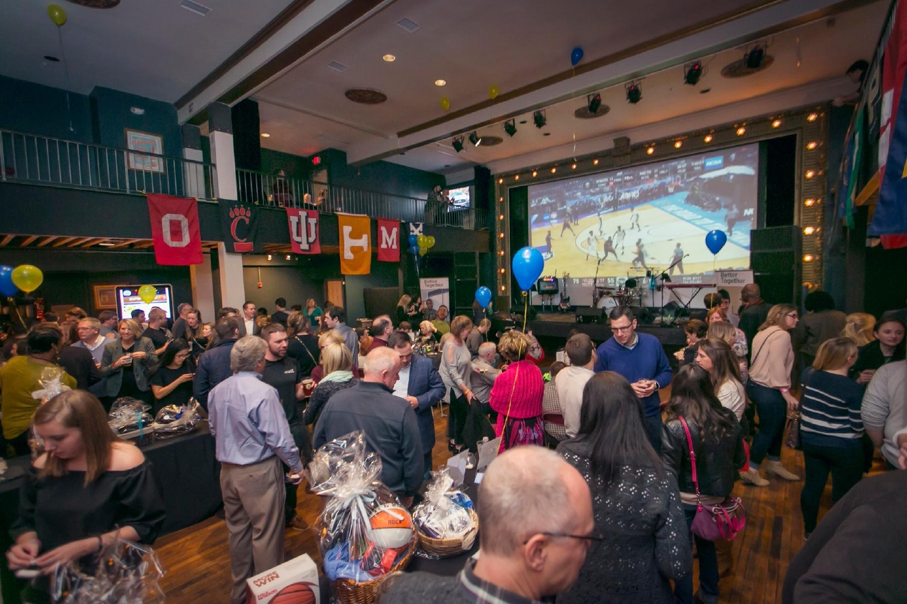 The Final Four Flyaway is a fundraiser which benefits Starfire Council (an organization that strives to build better lives for people with developmental disabilities). The party took place on Saturday, March 18 at the Woodward Theater in Over-the-Rhine. / Image: Mike Bresnen Photography