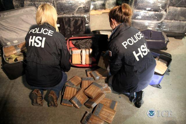 Agents document all the drugs seized in the bust.