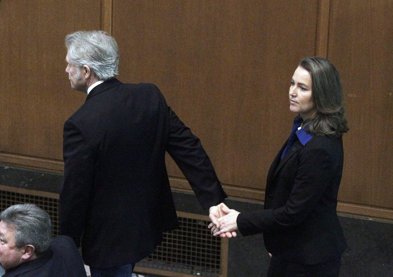 FILE - In this Jan. 12, 2015, file photo, Oregon Gov. John Kitzhaber escorts his fiancee, Cylvia Hayes, onto the House floor before he is sworn in for an unprecedented fourth term as governor in Salem, Ore. A federal appellate court panel has ruled that a subpoena seeking emails from former Oregon Gov. Kitzhaber as part of an influence-peddling investigation is too broad. Kitzhaber resigned in 2015 amid suspicion that his fiancee, Cylvia Hayes, used her relationship with him to earn lucrative consulting contracts. (AP Photo/Don Ryan, file)