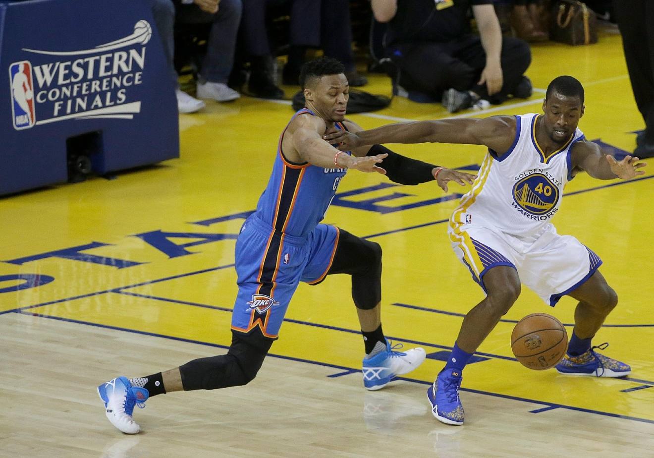 Oklahoma City Thunder guard Russell Westbrook, left, and Golden State Warriors forward Harrison Barnes (40) reach for a loose ball during the first half of Game 5 of the NBA basketball Western Conference finals in Oakland, Calif., Thursday, May 26, 2016. (AP Photo/Jeff Chiu)