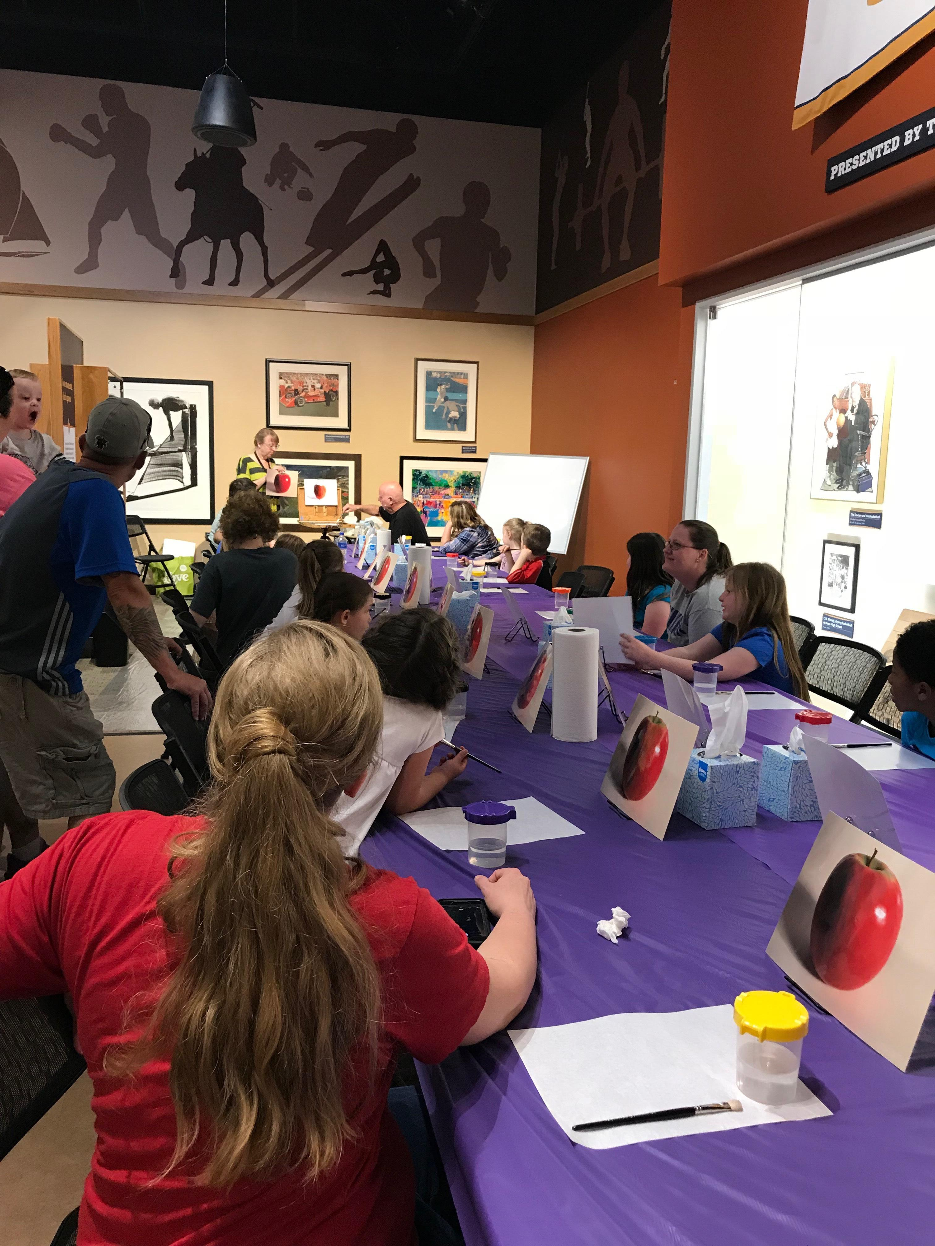 Children take a class with featured artist C.W. Mundy within the museum's National Art Museum of Sport. Select pieces are displayed from a collection of nearly 1,000 works. / Image courtesy of Children's Museum of Indianapolis // Published: 4.2.19