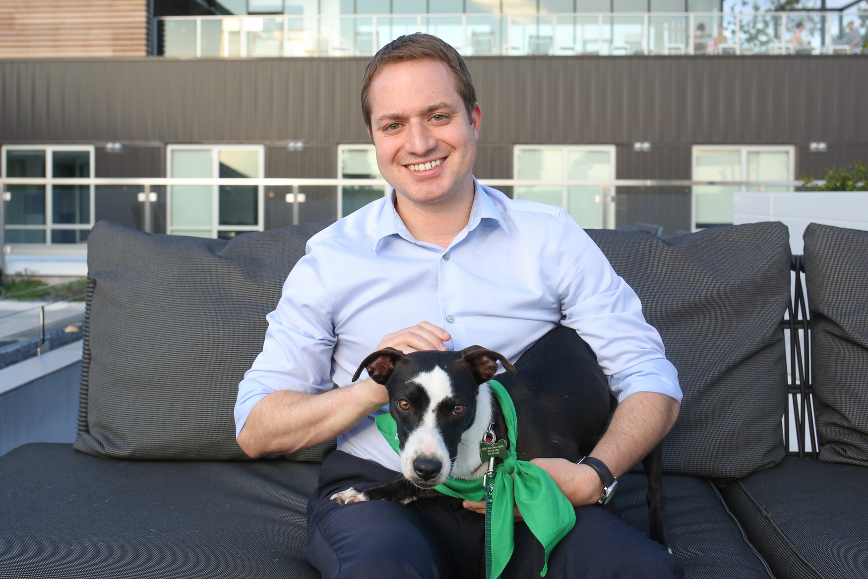 Meet Lua, a Bassett Hound/Terrier mix who is approximately 8-10 months old, and Matt, a 31-year-old human. Photo location: 880 P apartments (Image: Amanda Andrade-Rhoades/ DC Refined)