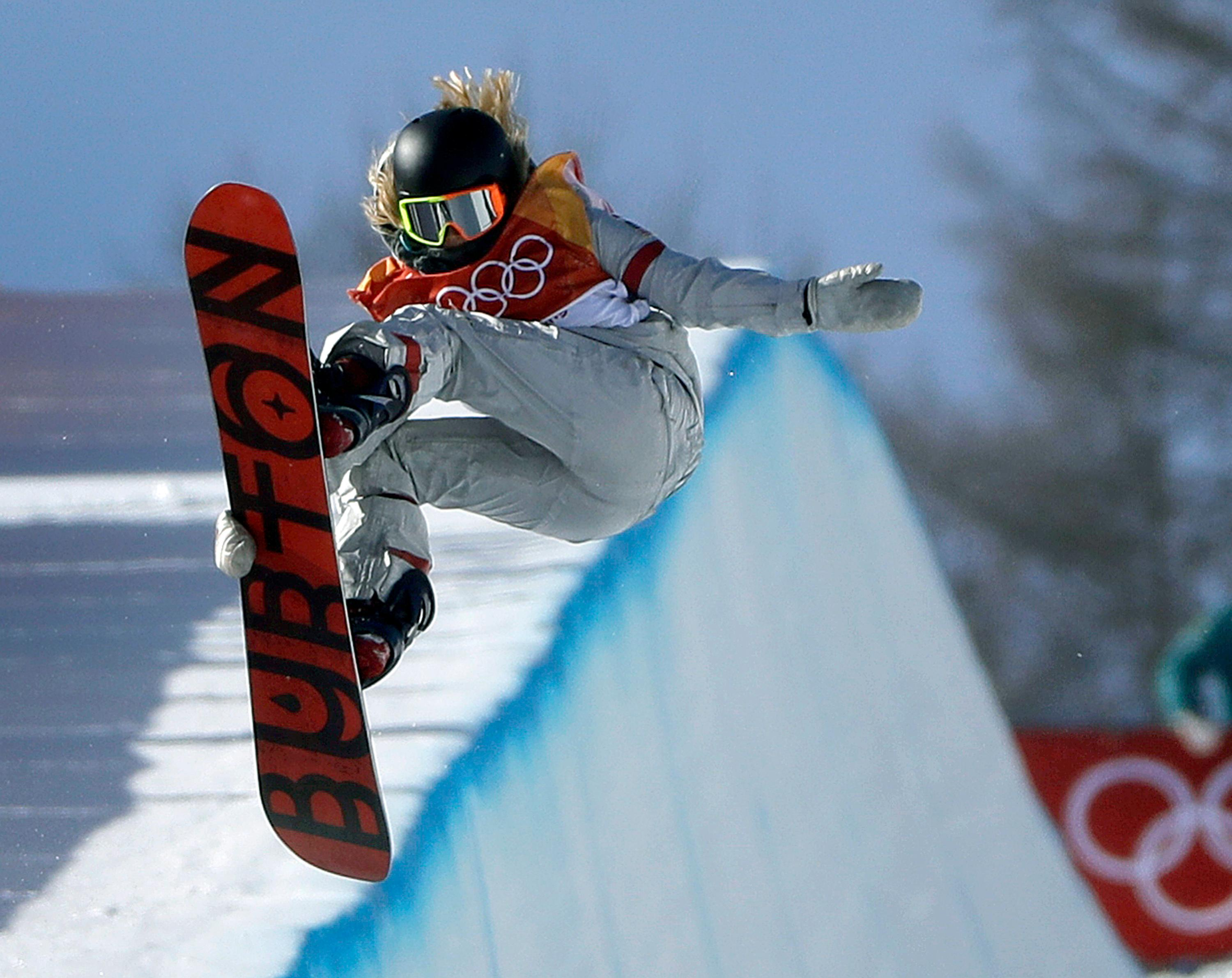 Chloe Kim, of the United States, jumps during the women's halfpipe finals at Phoenix Snow Park at the 2018 Winter Olympics in Pyeongchang, South Korea, Tuesday, Feb. 13, 2018. (AP Photo/Gregory Bull)