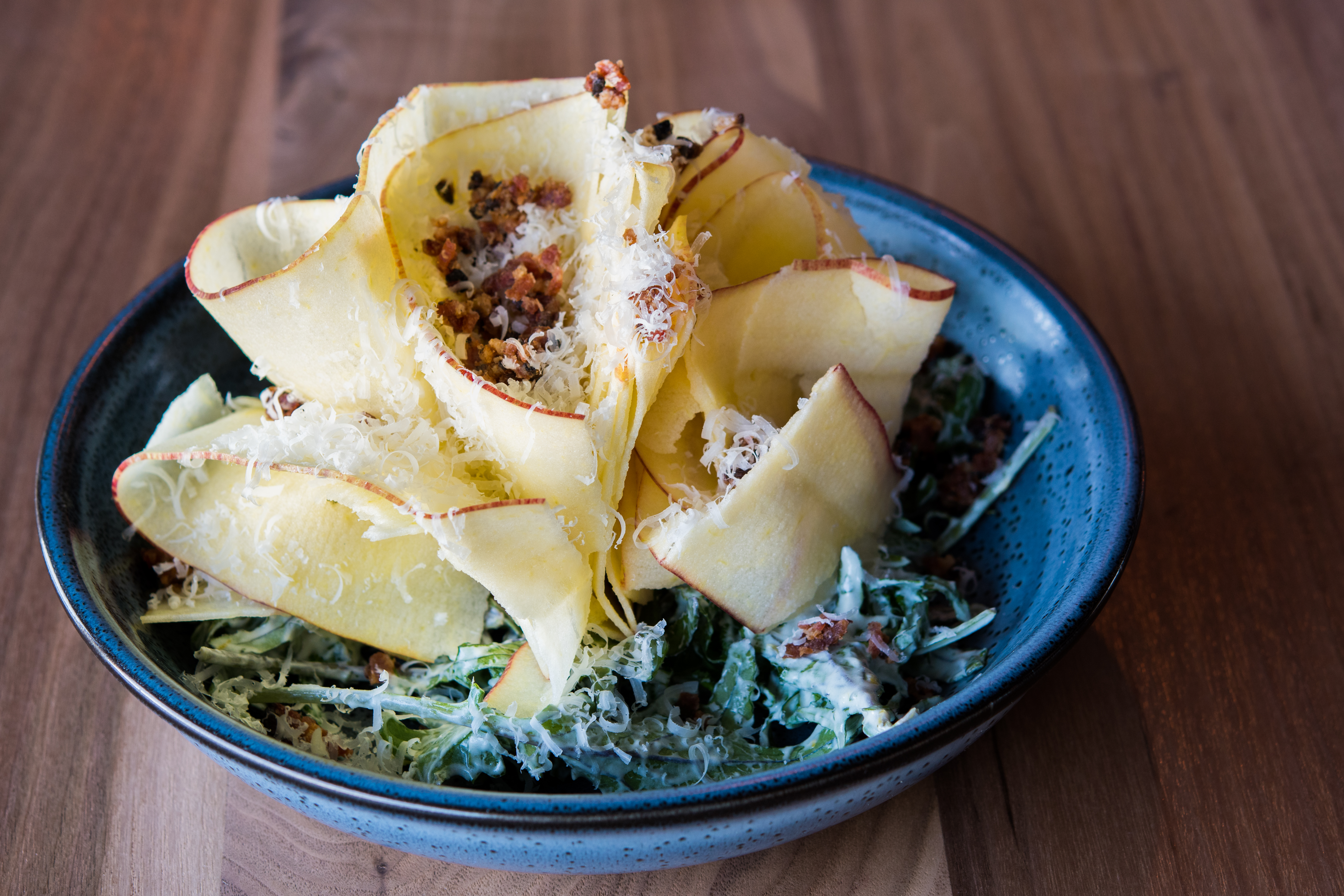 Fresh Apple Salad with bacon, mint, kale and creamy Parmesan dressing (Image courtesy of Fire Vine / Aerlume).
