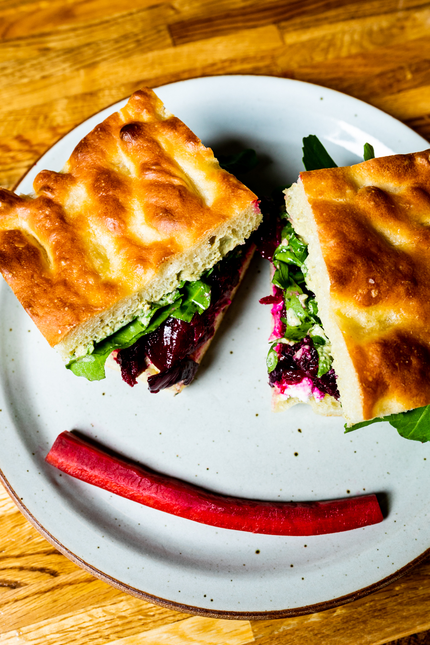 Veggie Sandwich with roasted beets, red onions, feta cheese, and herbed hummus on house focaccia bread / Image: Amy Elisabeth Spasoff // Published: 3.14.19