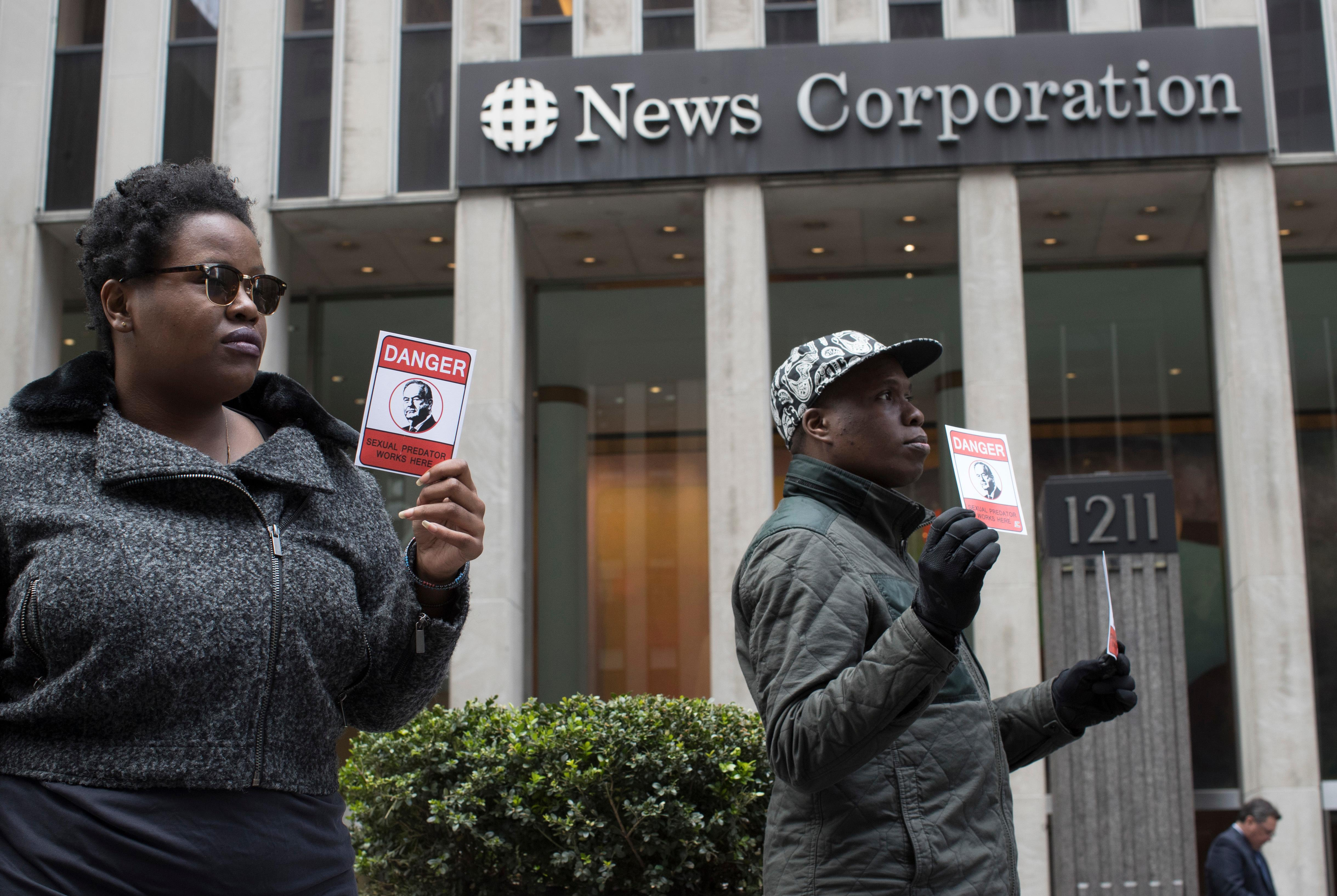 Activist with the Color of Change protest Bill O'Reilly outside the News Corp. headquarters in Midtown Manhattan, Wednesday, April 19, 2017. O'Reilly has lost his job at Fox News Channel after allegations that he sexually harassed women. (AP Photo/Mary Altaffer)