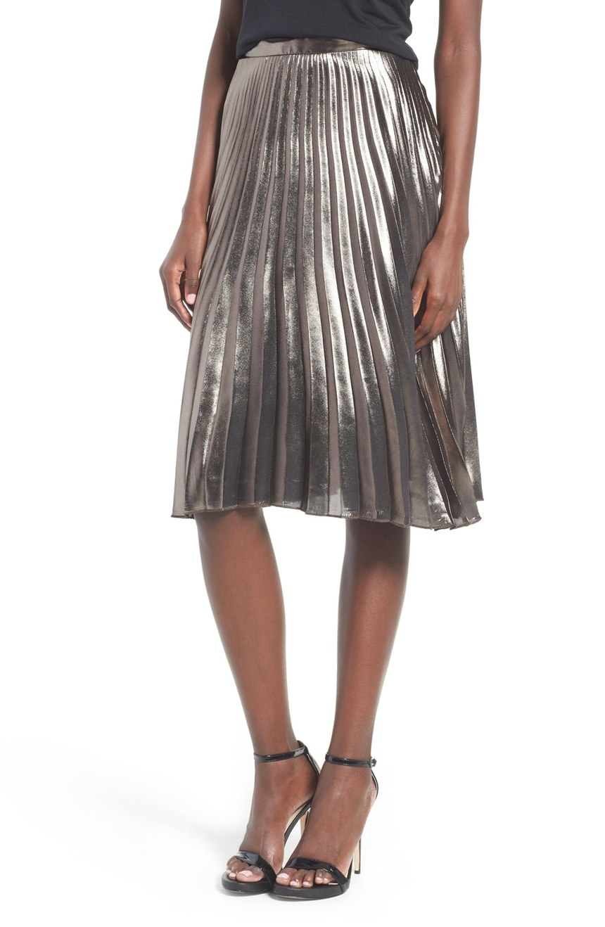 This 'ASTR Celeste Pleated Skirt' is a great versatile piece to add to your closet.  Plus it's flowy, comfy and metallic - making it a must have! Glam it up for NYE with chunky heels and a red lip. $110.00 (Image: Nordstrom)