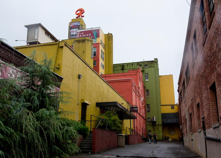 We all know the outside - heck, we drive by it all the time - but what is actually inside the old Rainier Brewery building? Take a look - it's a thriving compilation of small businesses, most artistic in nature, who treat each other like family. Check it out! (Image: Sy Bean / Seattle Refined)