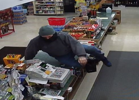 Portage Police are searching for this man linked to a possible armed robbery in Portage Tuesday night. The suspect description is the same as the suspect in the Kalamazoo robbery hours later.<p></p>