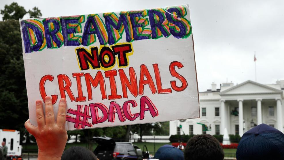 File Photo A Woman Holds Up A Signs In Support Of The Obama Administration Program Known As Deferred Action For Childhood Arrivals Or Daca