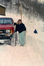 This was taken in 1993 after the blizzard hit! Our God-daughter Lindsey had spent the night with us and ended up getting stranded for almost a week. My husband had shoveled us out- Look how high the snow was- up near her hips!!
