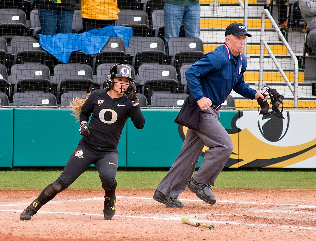 Oregon Ducks pinch runner Sammie Puentes (#5) scores the winning run against the California Golden Bears. The Ducks defeated the Golden Bears 2-1 in the second game of a three-game series. Photo by Dan Morrison, Oregon News Lab