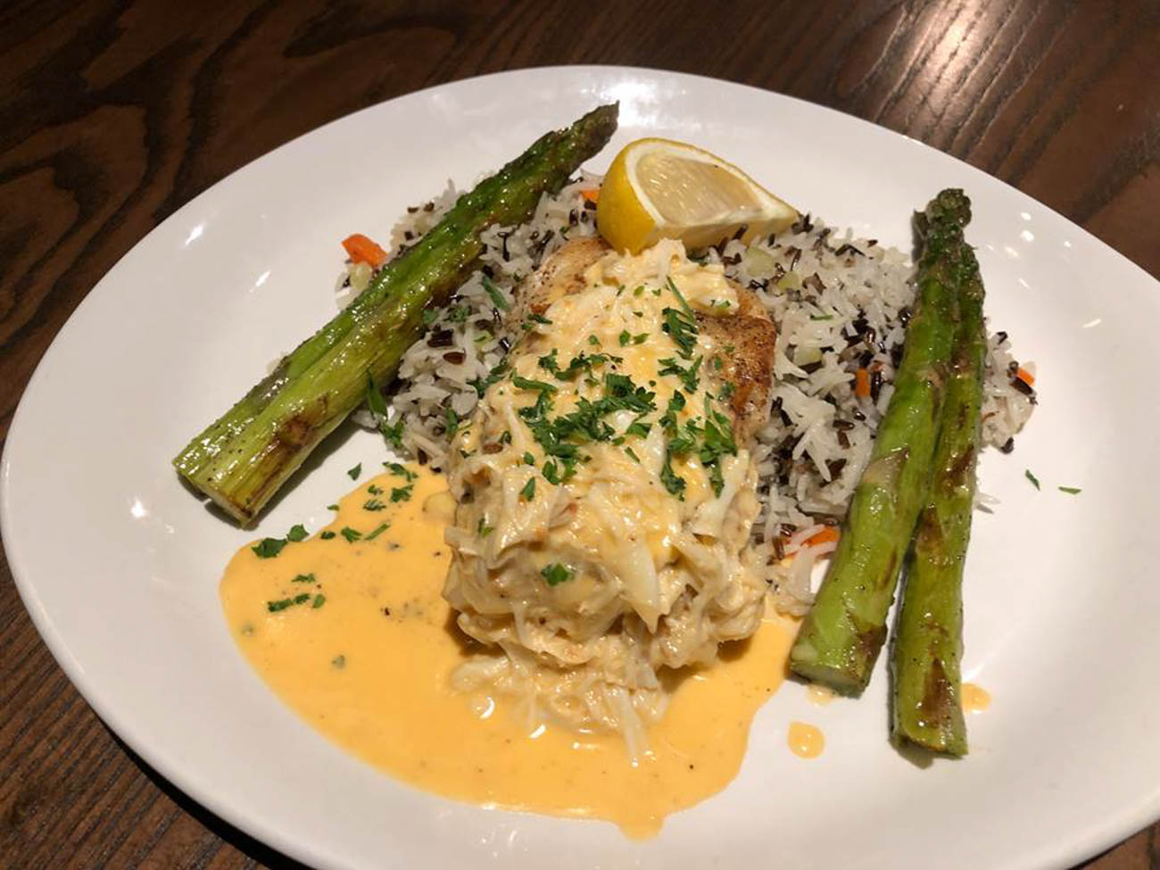 <p>FIRE's Chilean Sea Bass: pan-seared, risotto of the day, asparagus, and lobster cream sauce{&nbsp;}/ Image courtesy of RiverCenter Entertainment // Published: 6.20.19</p>
