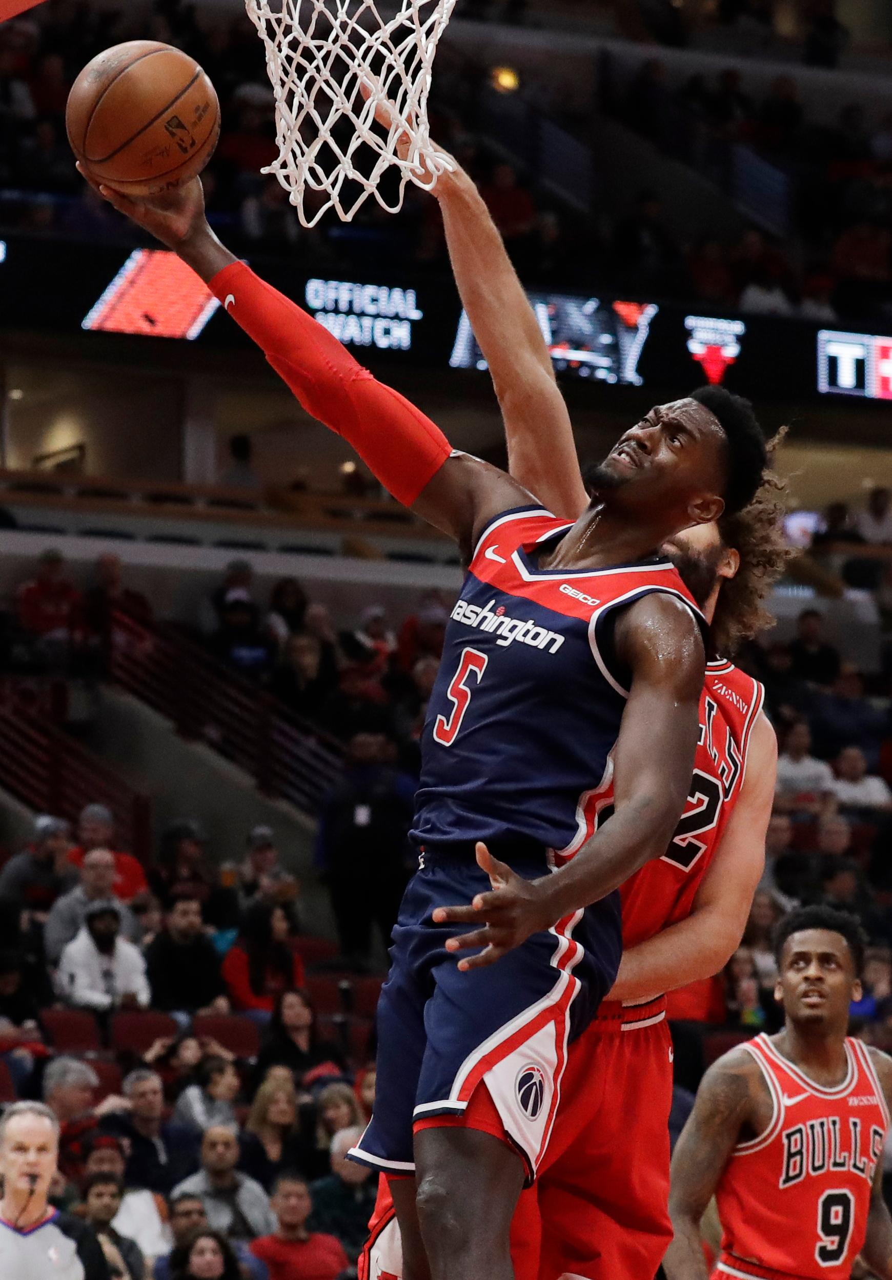 Washington Wizards forward Bobby Portis drives to the basket against Chicago Bulls center Robin Lopez during the first half of an NBA basketball game Wednesday, March 20, 2019, in Chicago. (AP Photo/Nam Y. Huh)