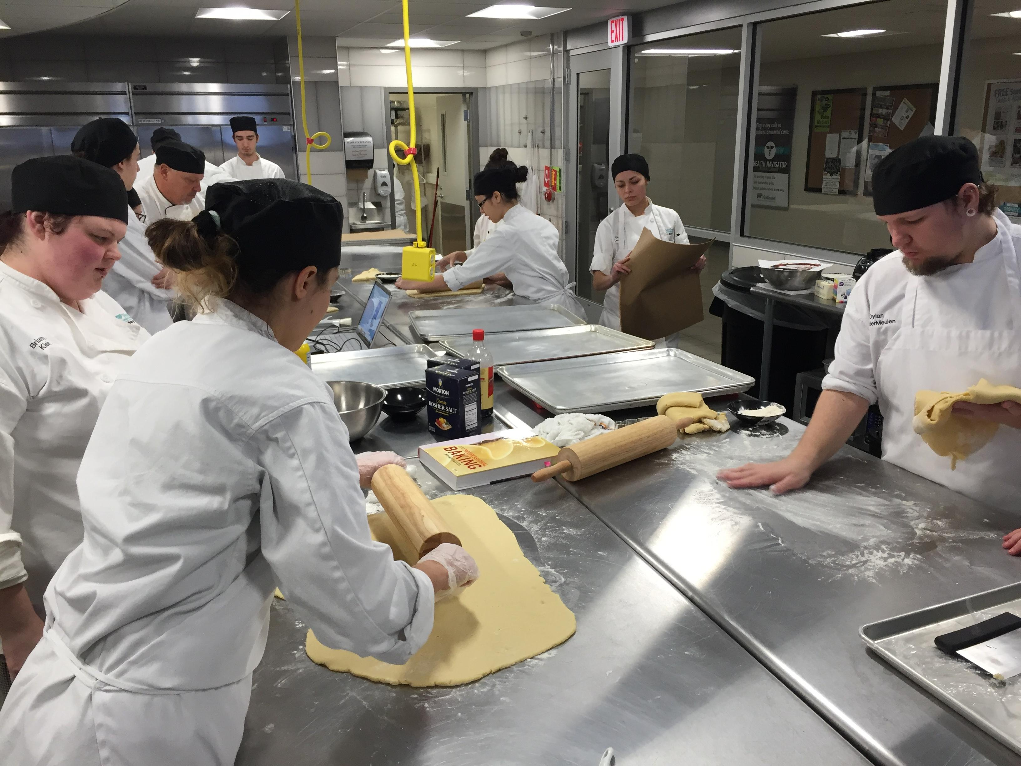NWTC students roll cookie dough in culinary lab, December 11, 2017 (WLUK/Eric Peterson)