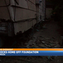 SUV smashes into home, knocks house off foundation