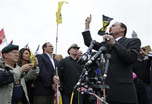 Sen. Mike Lee, R-Utah, speaks at a rally near the World War II Memorial in Washington Sunday, Oct. 13, 2013. The rally was organized to protest the closure of the Memorial and access to it by World War II veterans who traveled there on Honor Flight visits
