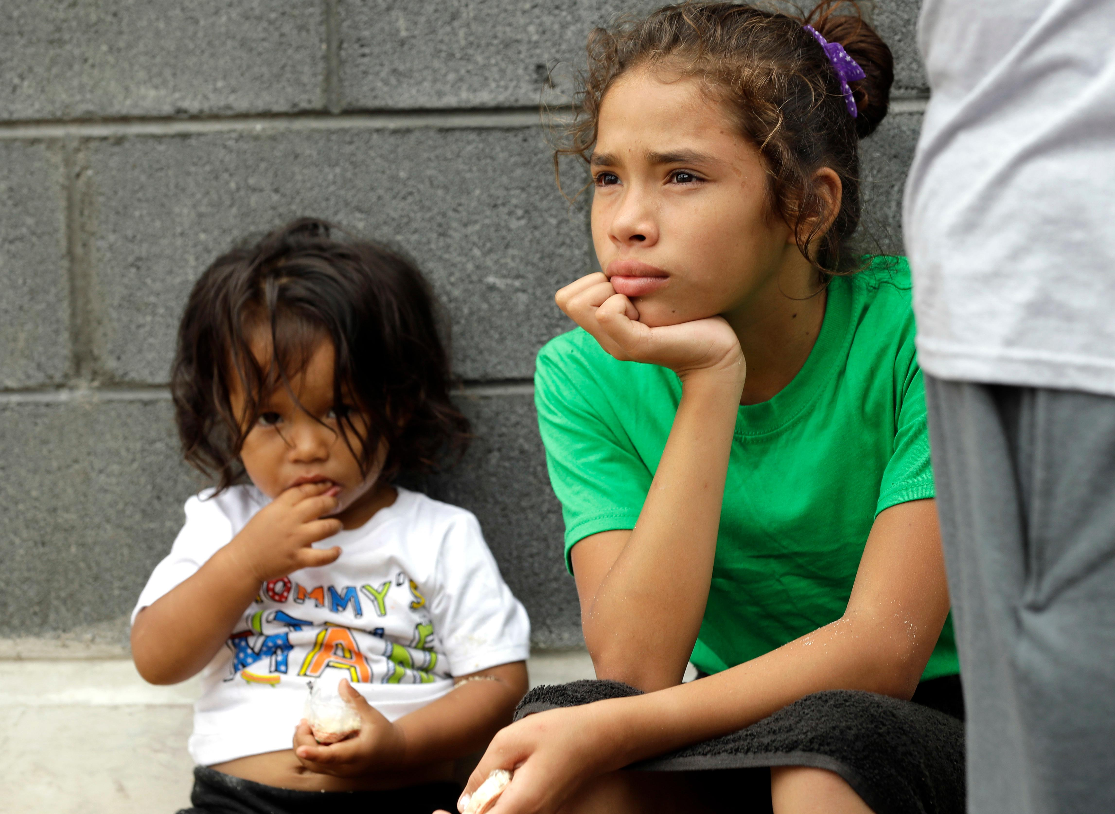 Angui Funes, right, sits with her brother, Jesus, after crossing the border back to Reynosa, Mexico, Thursday, June 21, 2018. The family, who was seeking asylum, said they were told by officials they would be separated so they voluntarily returned to Mexico. (AP Photo/David J. Phillip)