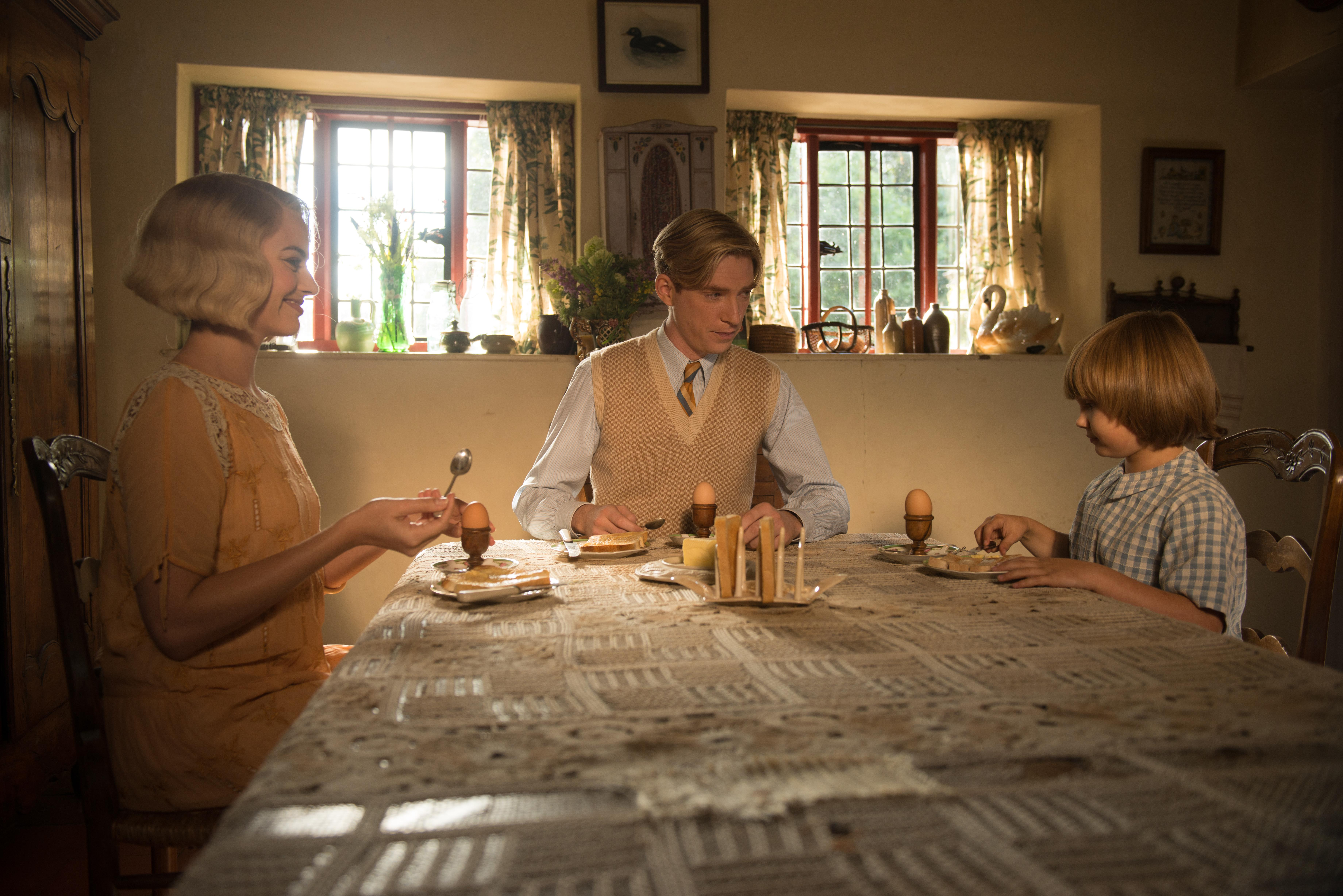 (From L-R): Margot Robbie, Domhnall Gleeson and Will Tilston in the film GOODBYE CHRISTOPHER ROBIN. Photo by David Appleby.{ }© 2017 Twentieth Century Fox Film Corporation All Rights Reserved