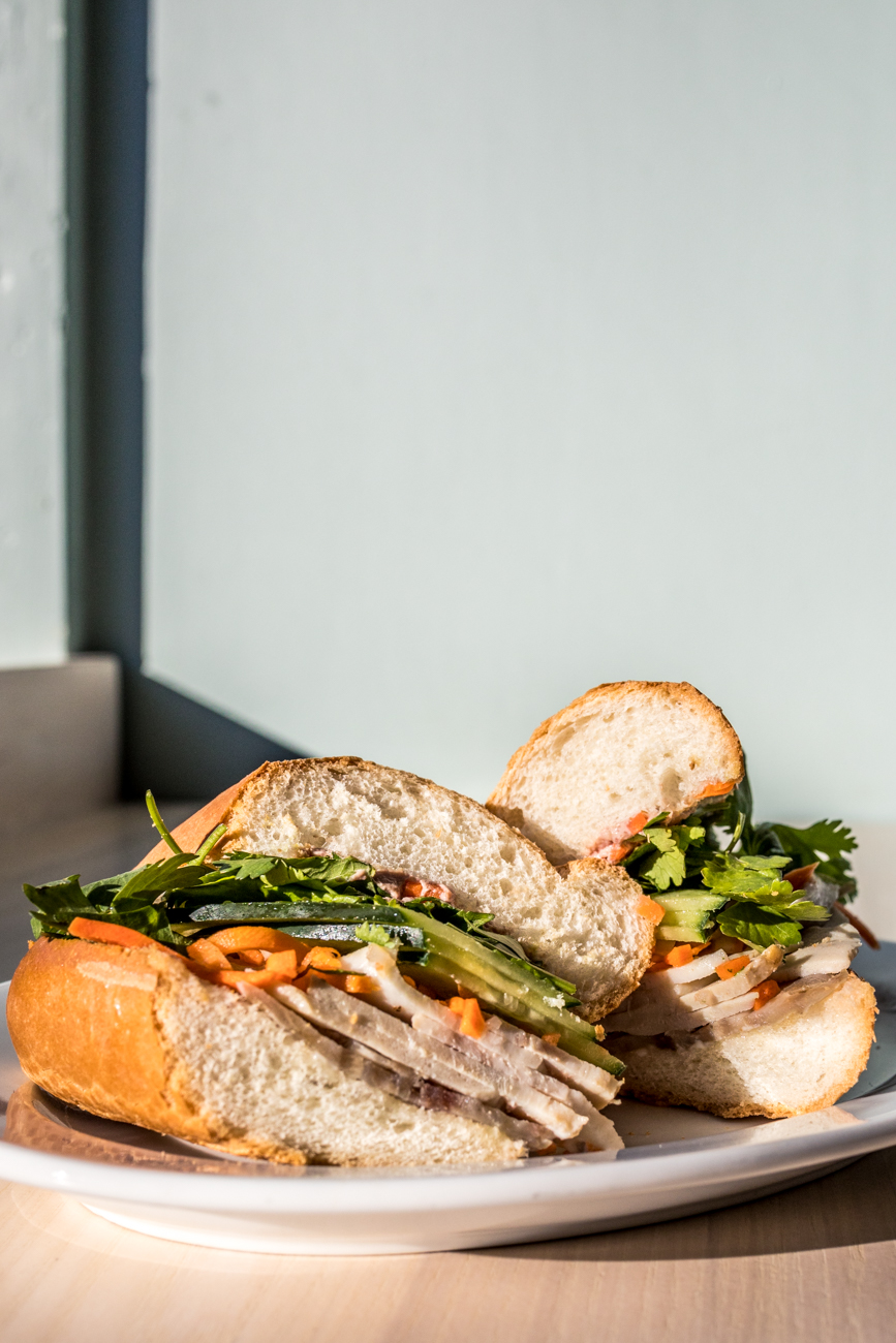 Banh Mi Dac Biet, a PLT special: xa xiu (bbq pork), cha lua (Vietnamese style pork roll), headcheese, pate, do chua (pickled veggies), cucumber, cilantro, and jalapenos on a baguette / Image: Catherine Viox{ }// Published: 12.28.19