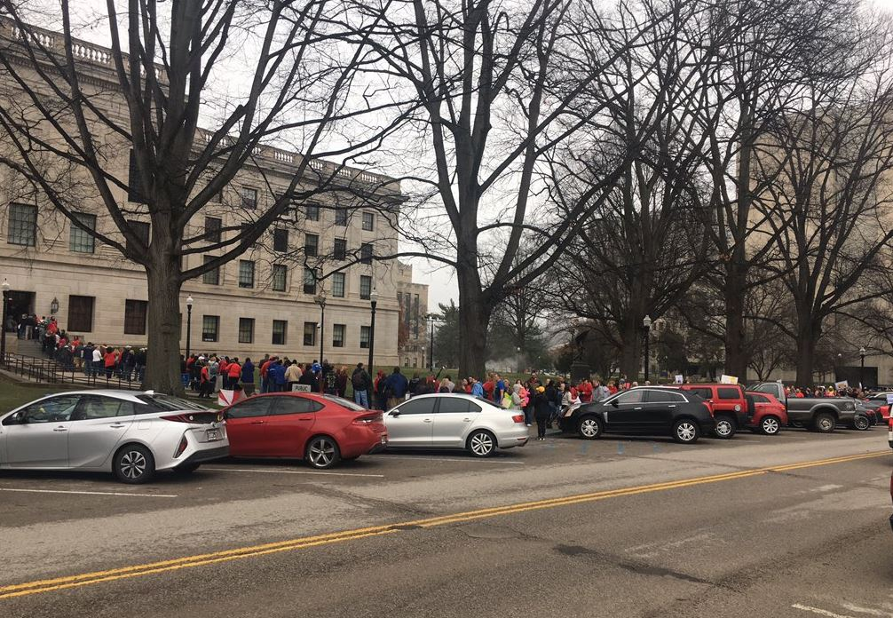 West Virginia teachers and school service personnel line up around the Capitol for entry. (WCHS/WVAH)<p></p>