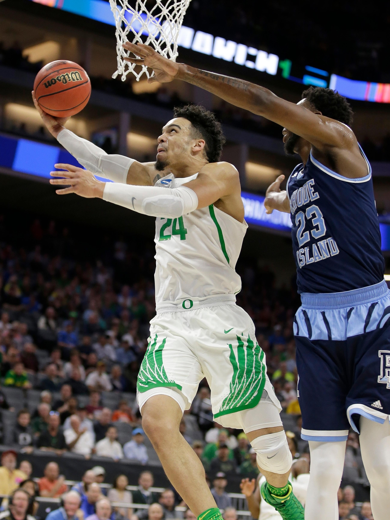 Oregon Ducks, Dillon Brooks, left, goes to the basket against Rhode Island forward Kuran Iverson during the first half of a second-round game of the NCAA men's college basketball tournament in Sacramento, Calif., Sunday, March 19, 2017. (AP Photo/Rich Pedroncelli )
