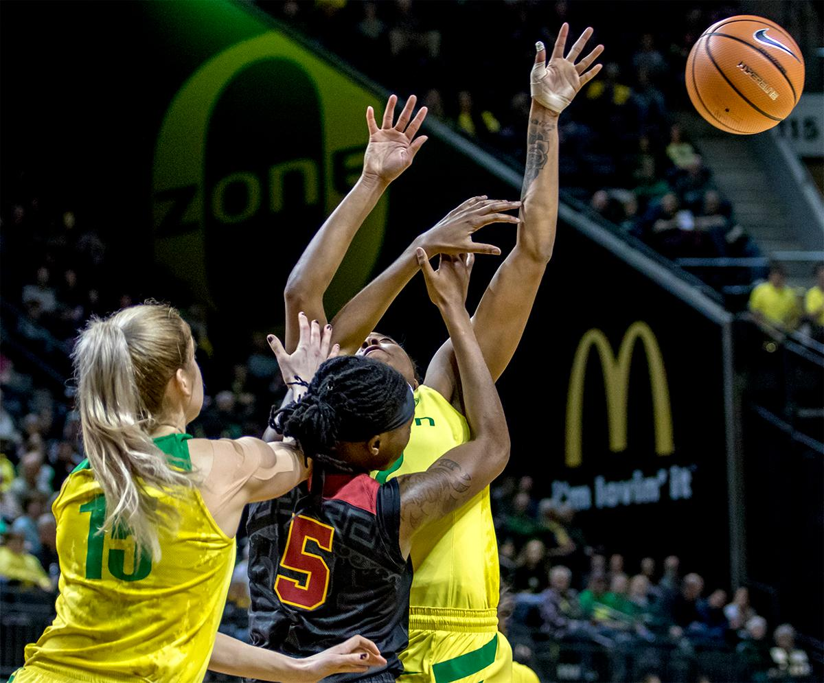 The ball flies free as the Duck's Oti Gildon (#32) and the Trojan's Ja'Tavia Tapley (#5) try to make the rebound. The Oregon Ducks defeated the USC Trojans 80-74 on Friday at Matthew Knight Arena in a  game that went into double overtime. Lexi Bando sealed the Ducks victory by scoring a three-pointer in the closing of the game. Ruthy Hebard set a new NCAA record of 30 consecutive field goals, the old record being 28. Ruthy Hebard got a double-double with 27 points and 10 rebounds, Mallory McGwire also had 10 rebounds. The ducks had four players in double digits. The Ducks are now 24-4, 13-2 in the Pac-12, and are tied for first with Stanford. Photo by August Frank, Oregon News Lab