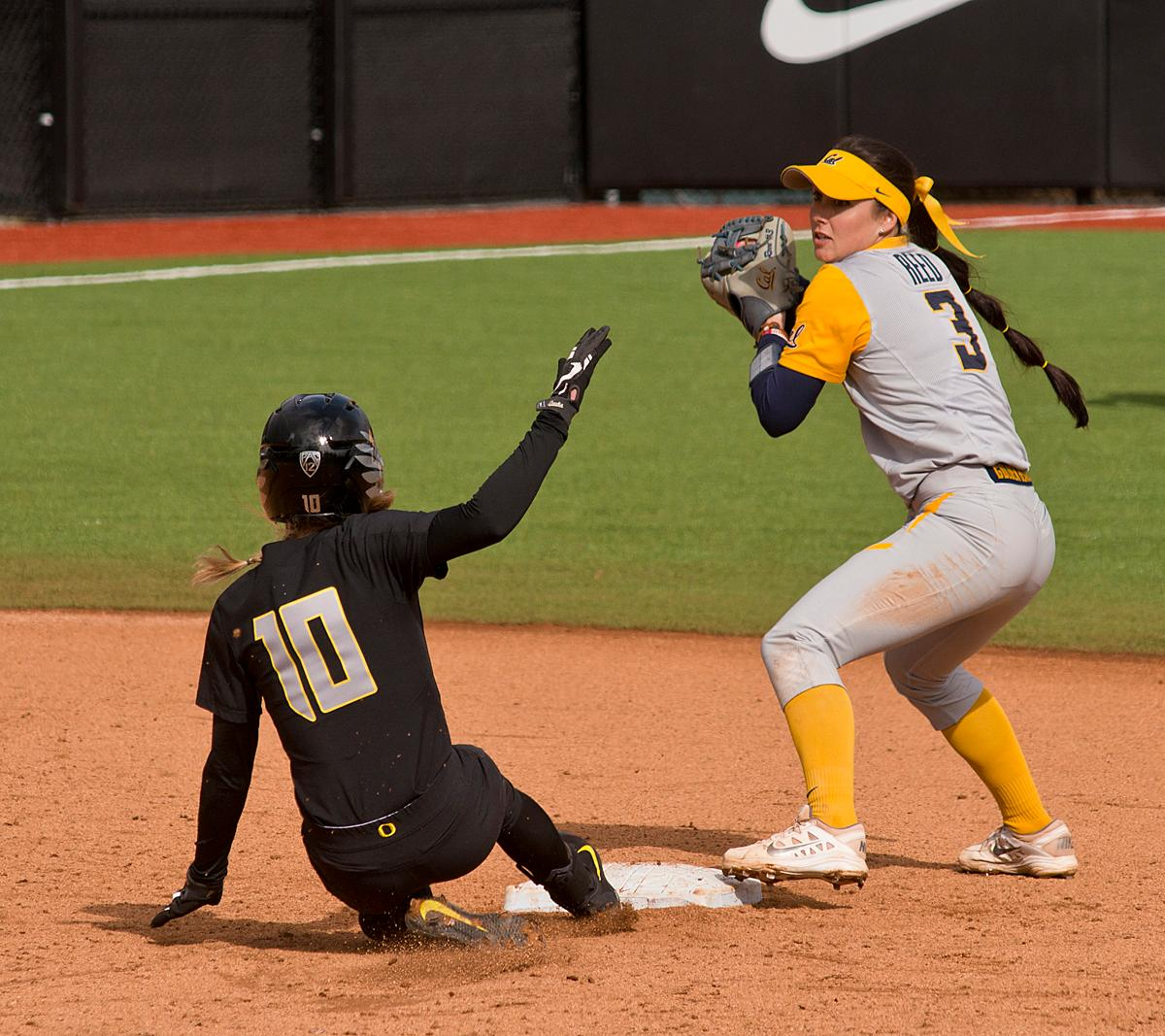 California Golden Bears second base player Kylie Reed (#3) turns a double play after getting Oregon Ducks Alexis Mack (#10) out. The Ducks defeated the Golden Bears 2-1 in game two of a three-game series. Photo by Dan Morrison, Oregon News Lab