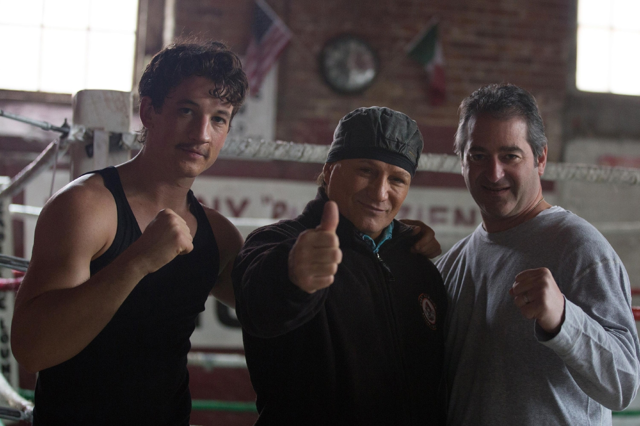 (Left to right) Miles Teller, Vinny Paz and Producer Chad Verdi on the set of BLEED FOR THIS. (Courtesy of Open Road Films)