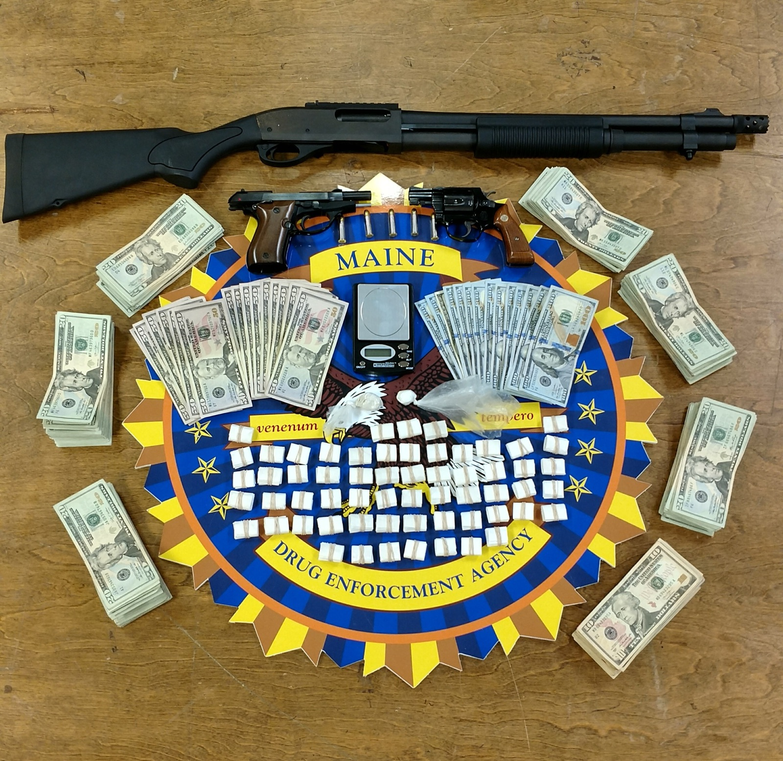They say they seized 600 'tickets,' or dosage units of heroin, an additional 4.4 grams of heroin, 4.5 grams of crack cocaine and $9,863 in suspected drug proceeds. Two handguns and a shotgun were also confiscated, two of which had been reported stolen, according to police. (Lewiston Police Department)