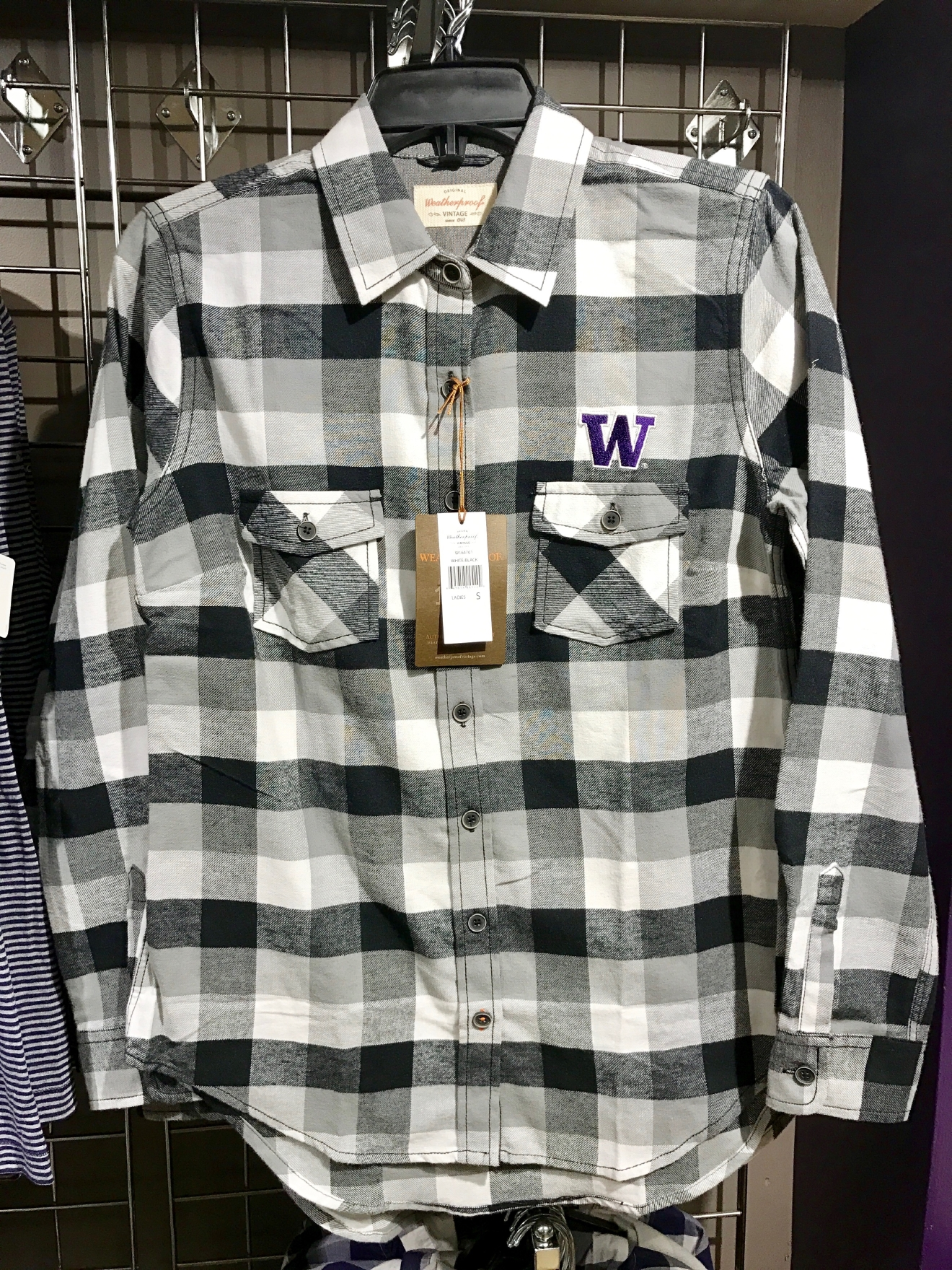 UW Plaid Shirt - $60                                          Whether you're a current student, alum, or just *love* the Dawgs, it's a pretty exciting time to be a Husky fan right now. Just to catch you up, the University of Washington football team is having one of their best seasons in years, and will be playing the Peach Bowl in Atlanta on December 31st. If you know a Dawg fan, they're probably salivating at the mouth right about now. Which is why it's a perfect time to give them a themed gift! Here are some of the coolest Husky gear we saw at the University Bookstore on the Avenue during our last visit. Pro Tip: They're open 10 a.m. - 7 p.m. on Christmas Eve! (Image: Britt Thorson / Seattle Refined)