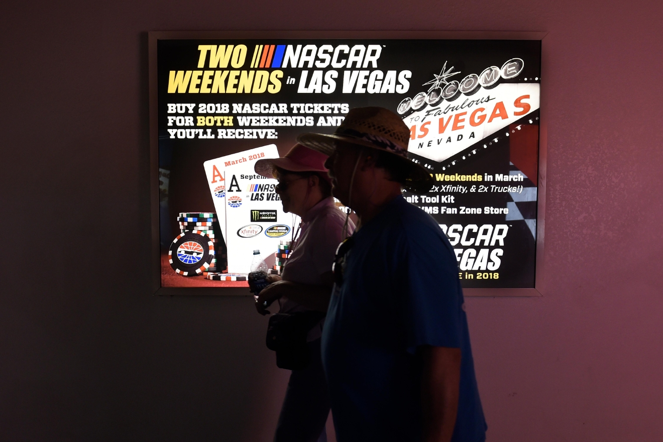 Fans walk by a sign advertising the just announced second Las Vegas NASCAR race during the NASCAR Xfinity Series Boyd Gaming 300 Saturday, March 11, 2017, at the Las Vegas Motor Speedway. (Sam Morris/Las Vegas News Bureau)