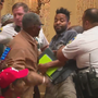 Two arrested at City Hall during hearing on illegal gun bill