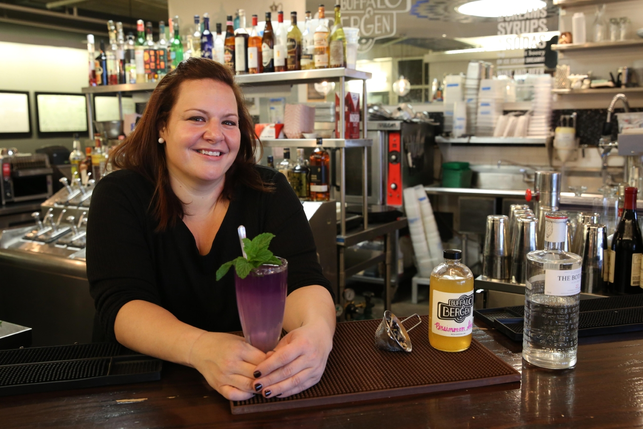 "Gina Chersevani, the owner of Union Market's Buffalo & Bergen, knows a thing or two about crafting cocktails - she's been in the industry for 18 years. However, when the temperature starts to drop, Chersevani reaches into her stash of tea for an warm, gin-based concoction she calls a ""Blue Christmas."" (Amanda Andrade-Rhoades/DC Refined)"