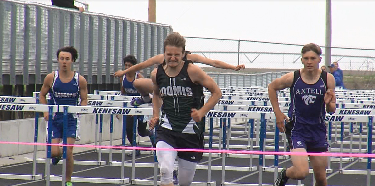 Isaac Wahls (center) from Loomis edges out the competition in the boys 110 M high hurdles, May 10, 2017, during the D8 district meet (NTV News)