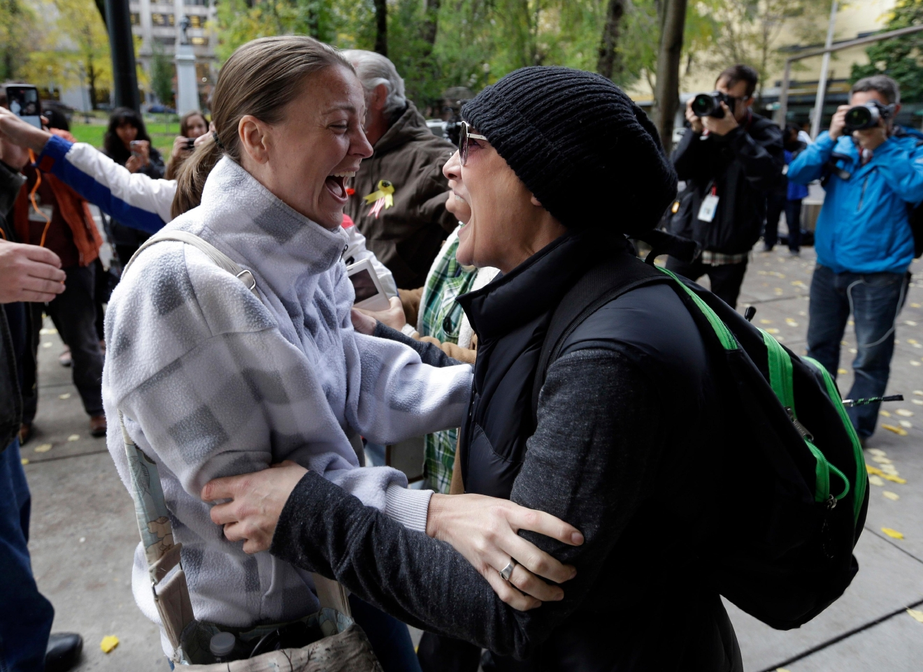Supporters celebrate after hearing a verdict outside federal court in Portland, Ore., Thursday, Oct. 27, 2016. A jury exonerated brothers Ammon and Ryan Bundy and five others of conspiring to impede federal workers from their jobs at the Malheur National Wildlife Refuge. (AP Photo/Don Ryan)