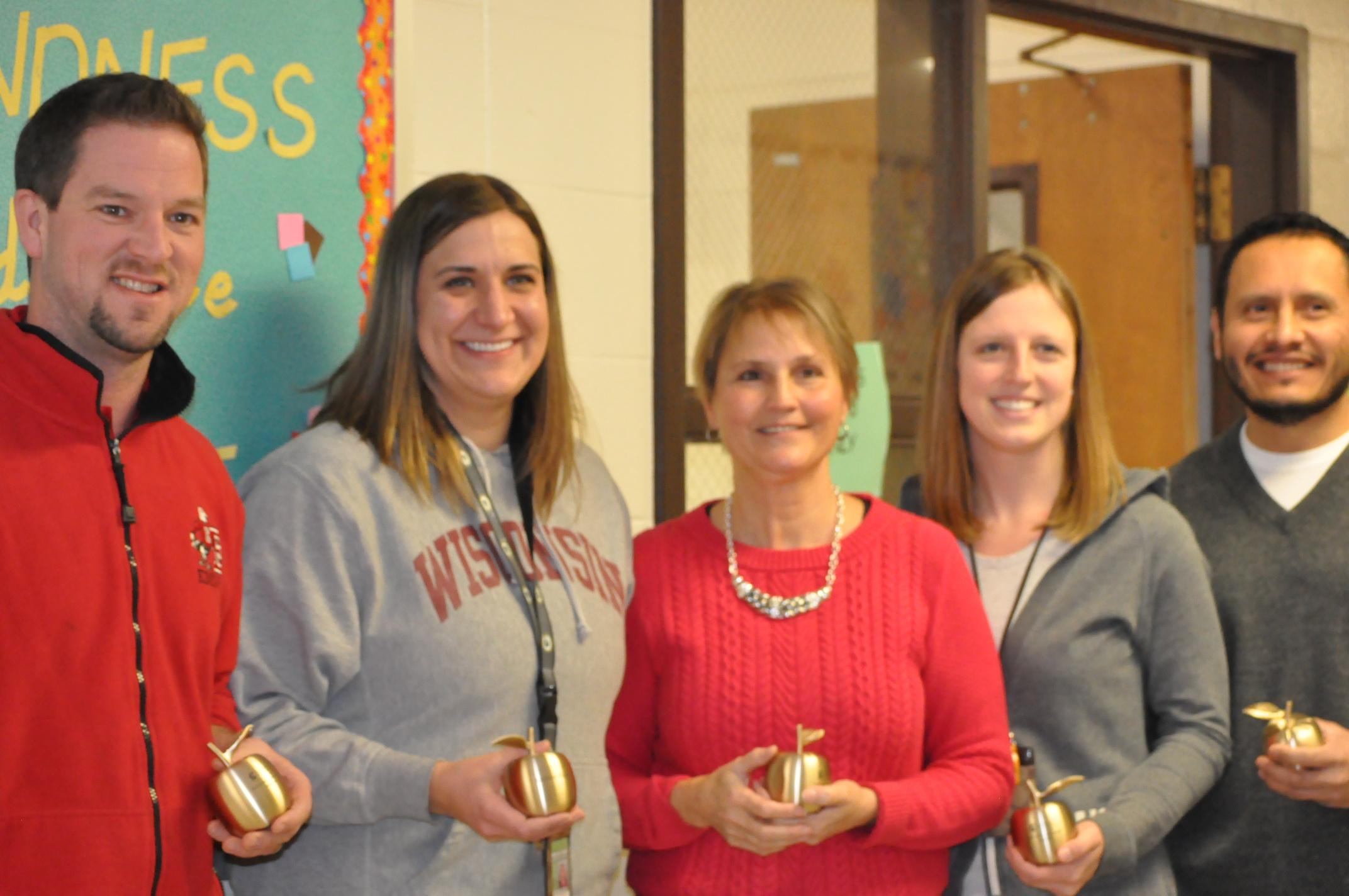 The Edison Middle School 6th grade mathematics team, Jared Barker, Andrea Huggett, Debbie Joski, Holly Snyder and Eduardo Pineda, pose with their Golden Apple Awards Feb. 7, 2018, in Green Bay. (WLUK/Donna Fischer)