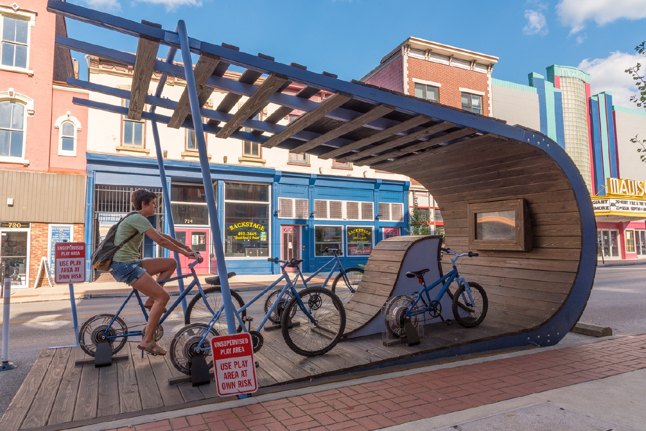 Curb'd: 2016 art installations built on parking spaces (called parklets) that included hopscotch gardens, speed bag punching, stationary bikes that power an outdoor theater, and more. / Image: Phil Armstrong, Cincinnati Refined // Published: 1.24.18