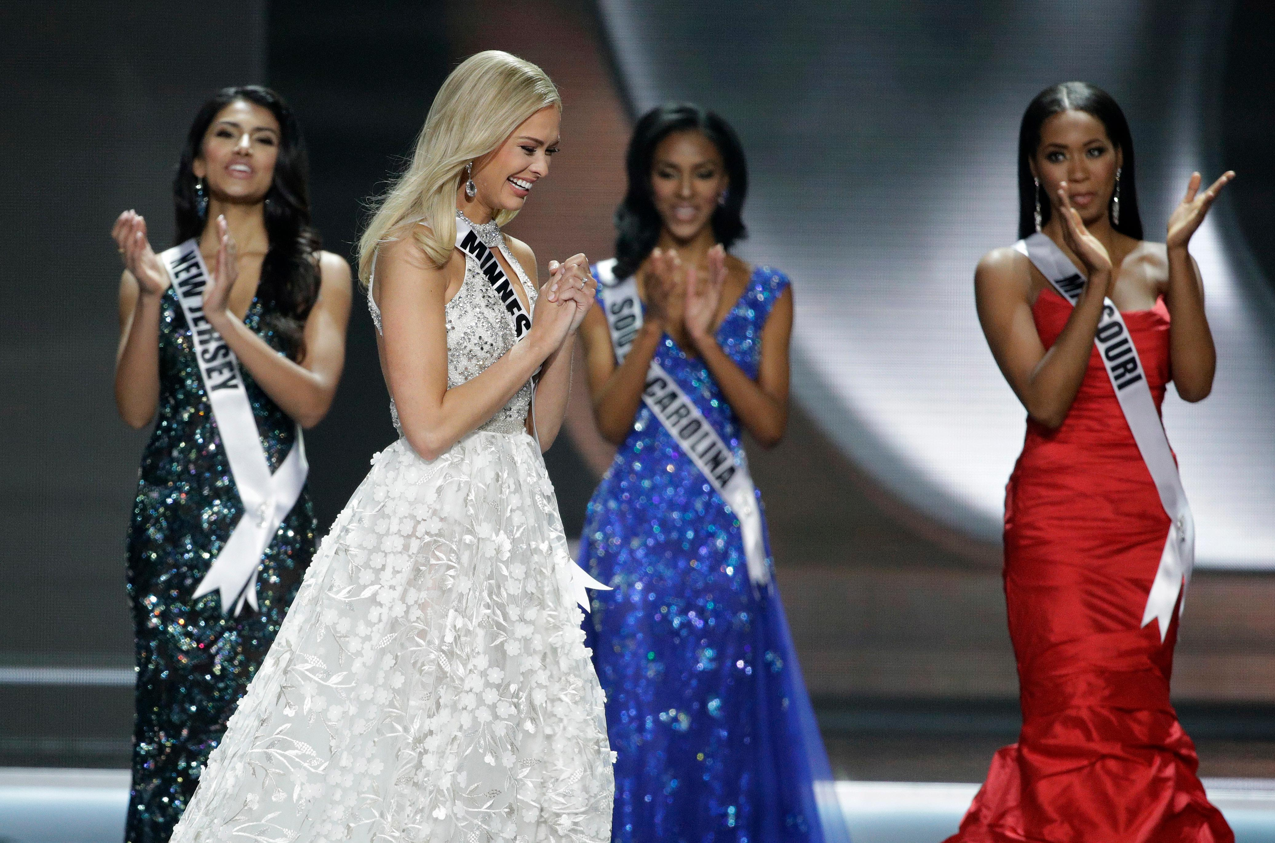 Miss Minnesota USA Meridith Gould celebrates making the top five during the Miss USA contest Sunday, May 14, 2017, in Las Vegas. (AP Photo/John Locher)