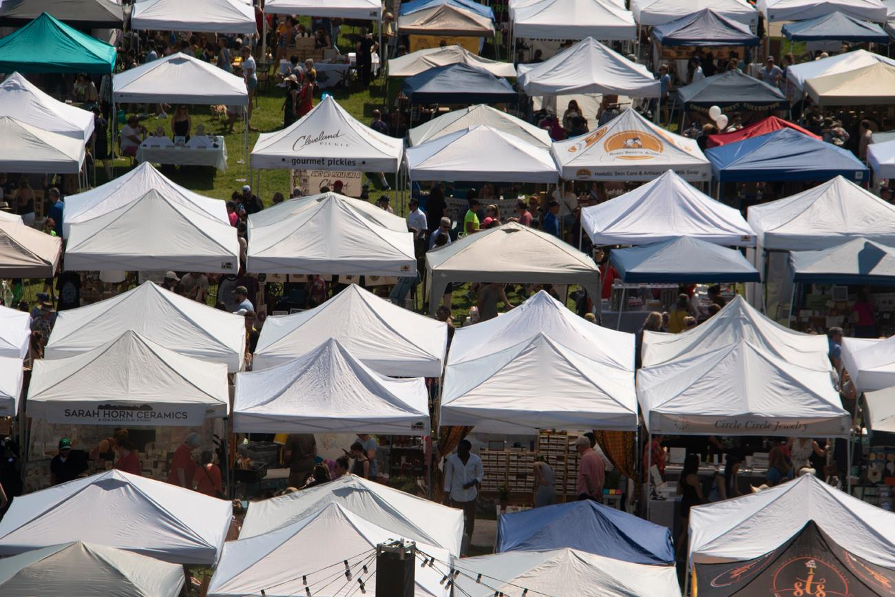 The City Flea, the seasonal outdoor market of vendors in tents set up on the Washington Park lawn, opened for its first event of 2019 on Saturday, May 18. Thousands took to the park to peruse homemade clothing and beauty care items, as well as art, food, and more. City Flea will be in Washington Park again on June 15th, July 20th, August 17th, September 14th, October 19th, and December 14th with a special and final Holiday Market this year. / Image: Dr. Richard Sanders // Published: 5.18.19