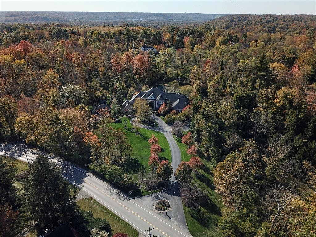 <p>9435 Shawnee Run Road in Indian Hill - $3,475,000 / This is definitely the biggest home on the list. At a whopping 8,347 square feet, this six-bedroom, nine-bathroom mansion in Indian Hill is situated on over five acres of land and is surrounded by woods. For those who want to escape the city and live in nature, this is it. The place has its own indoor basketball court, a theater, a full bar, a pool, a tennis court, a double curved staircase...the list goes on. / Our favorite feature: That grand entry is pretty slick, not gonna lie. / Image:{&nbsp;}Katy Nelson // Published: 1.9.20</p>