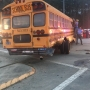 School bus wrecks, overturns near school