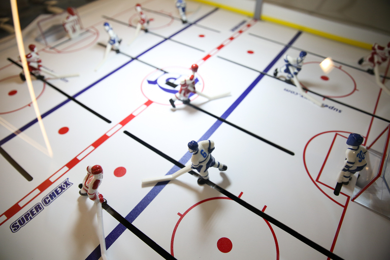 Can we make it a law that every office should come quipped with an air hockey table to destress? (Image: Amanda Andrade-Rhoades/ DC Refined)