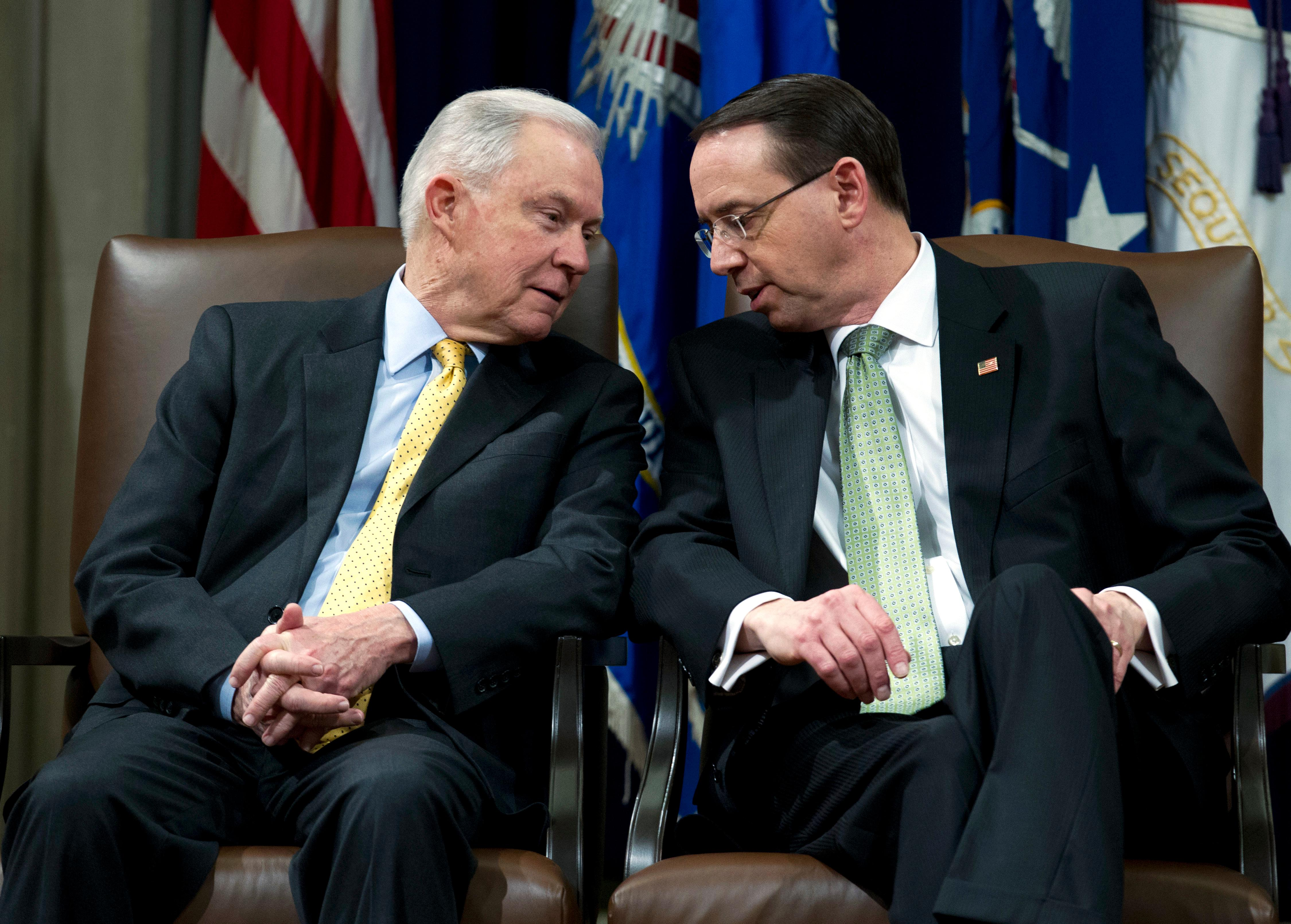 Attorney General Jeff Sessions speaks with Deputy Attorney General Rod Rosenstein, during the opening of the summit on Efforts to Combat Human Trafficking at Department of Justice in Washington, Friday, Feb. 2, 2018. President Donald Trump, dogged by an unrelenting investigation into his campaign's ties to Russia, lashes out at the FBI and Justice Department as politically biased ahead of the expected release of a classified Republican memo criticizing FBI surveillance tactics.  (AP Photo/Jose Luis Magana)